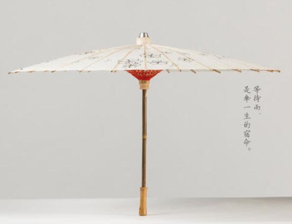 有伞字的古风句子 形容油纸伞的唯美句子